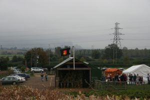 Image of a small barn, pumpkins and marquee